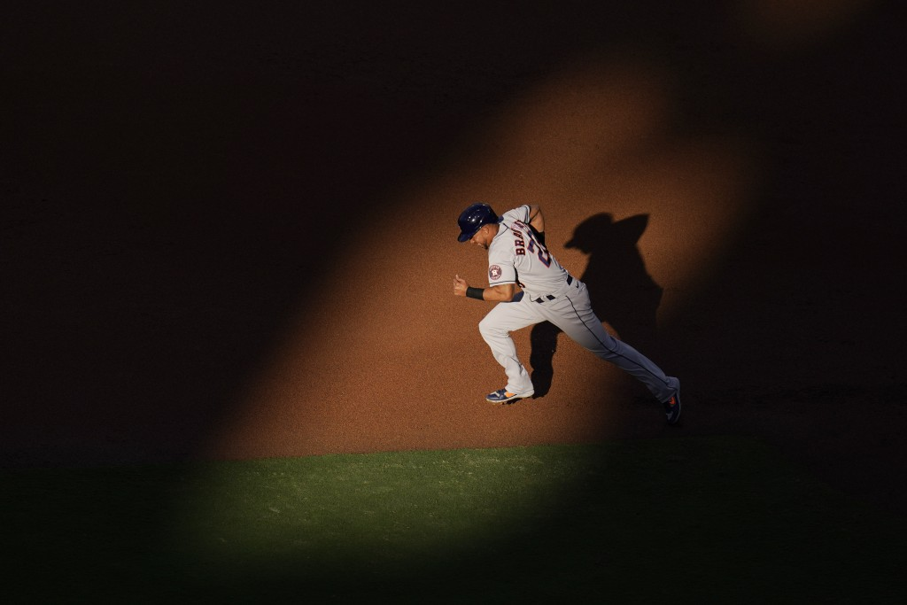 Houston Astros Michael Brantley (23) runs to steal second during the first inning in Game 1 of a baseball American League Championship Series against ...