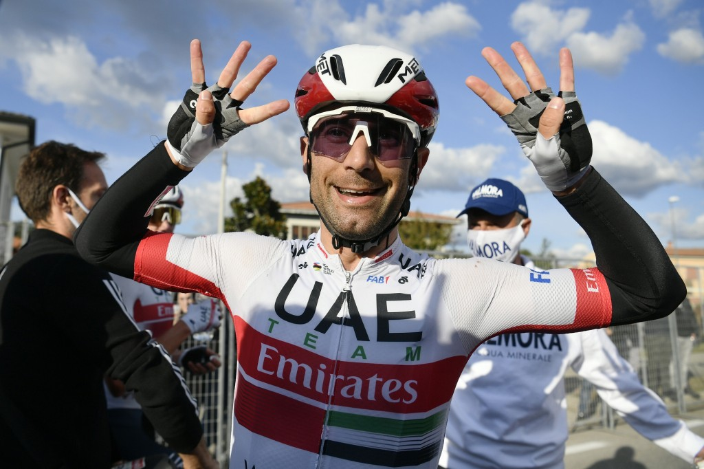 Italy's Diego Ulissi indicates eight, the number of his wins at Giro d'Italia, as he celebrates after winning the 13th stage of the Giro d'Italia, tou...