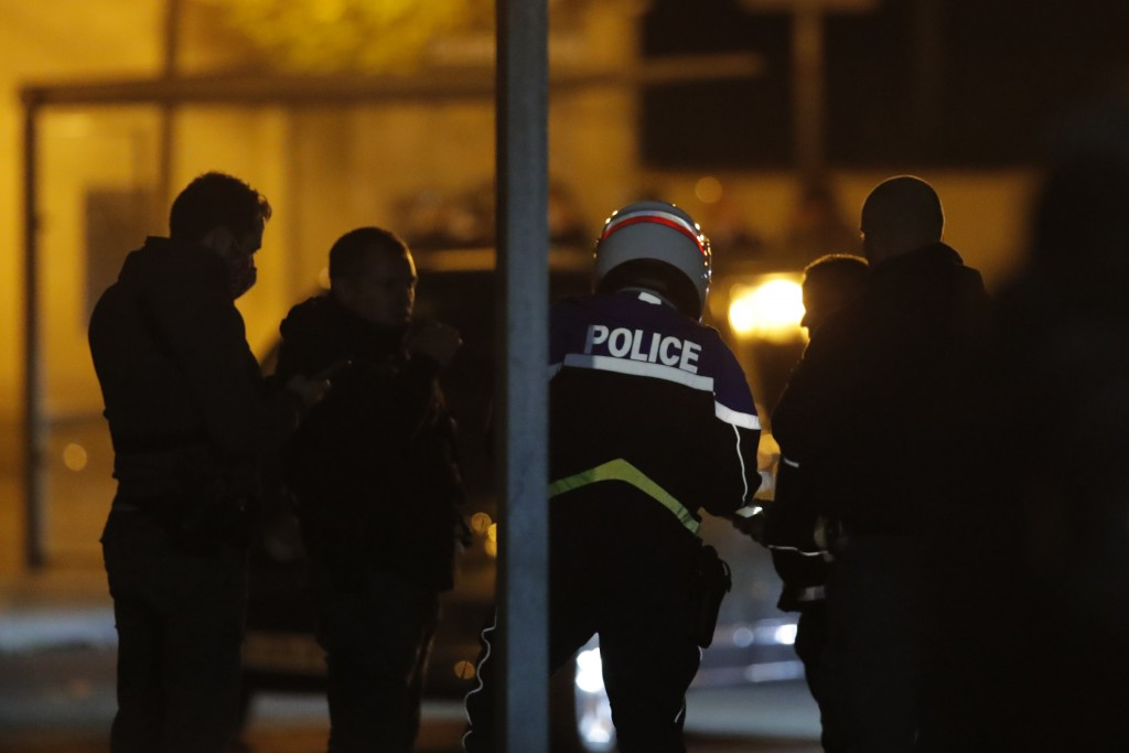 French police officers gather outside a high school after a history teacher who opened a discussion with students on caricatures of Islam's Prophet Mu...