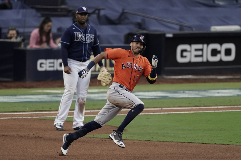 Houston Astros Carlos Correa runs to second after hitting a double against the Tampa Bay Rays during the seventh inning in Game 6 of a baseball Americ...