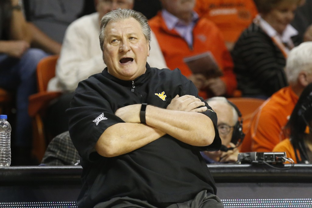 FILE- In this Jan. 6, 2020, file photo, West Virginia head coach Bob Huggins reacts during an NCAA college basketball game against Oklahoma State in S...