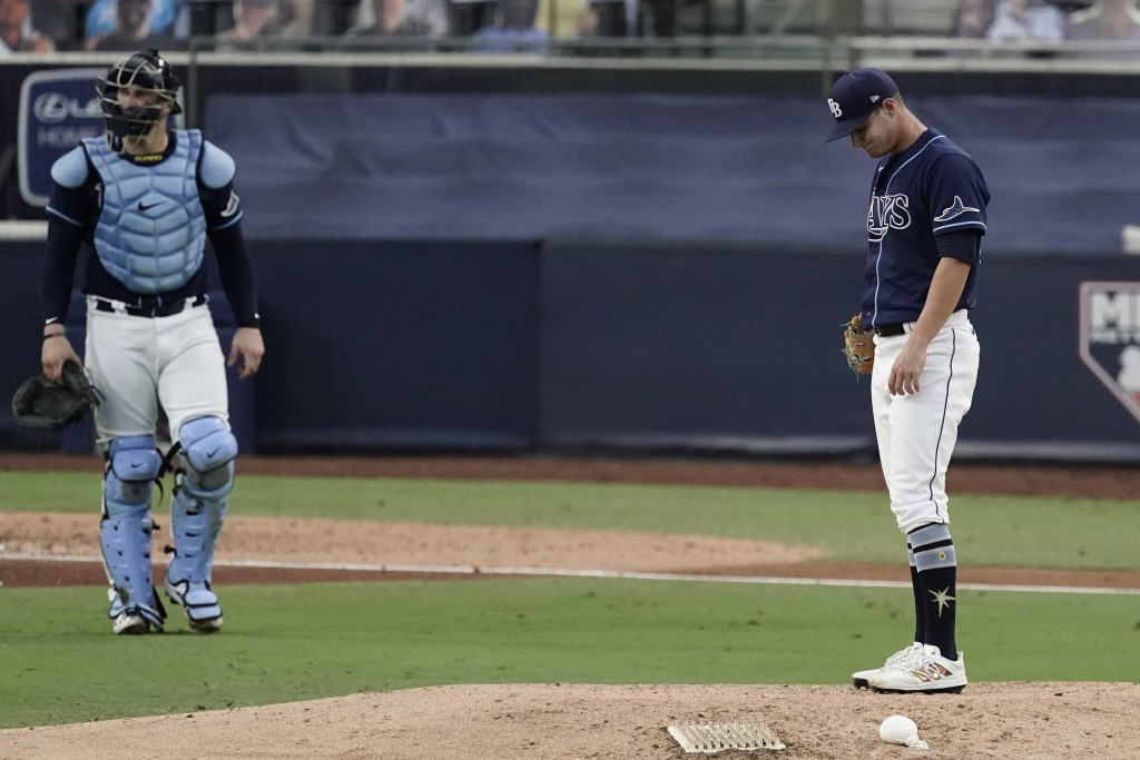 Tampa Bay Rays pitcher Shane McClanahan, right, waits to be relieved during the seventh inning in Game 6 of a baseball American League Championship Se...