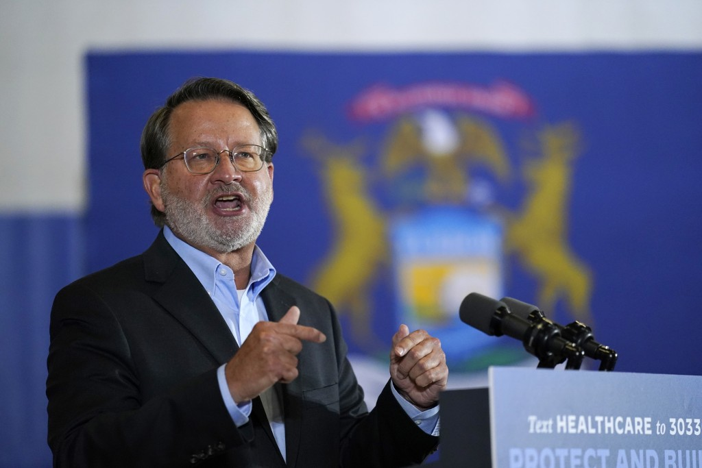 Sen. Gary Peters, D-Mich., speaks during an event with Democratic presidential candidate former Vice President Joe Biden at Beech Woods Recreation Cen...