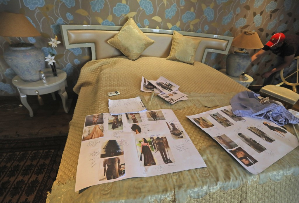 Photographs of models are spread on a bed during a shoot for the Lotus Make-up India Fashion Week, at the farmhouse of a designer in New Delhi, India,...
