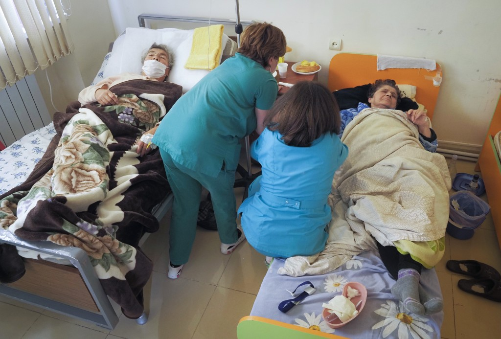 Nurses administer medicine to a patient wounded from shelling by Azerbaijan's artillery in a hospital, during a military conflict in Stepanakert, the ...