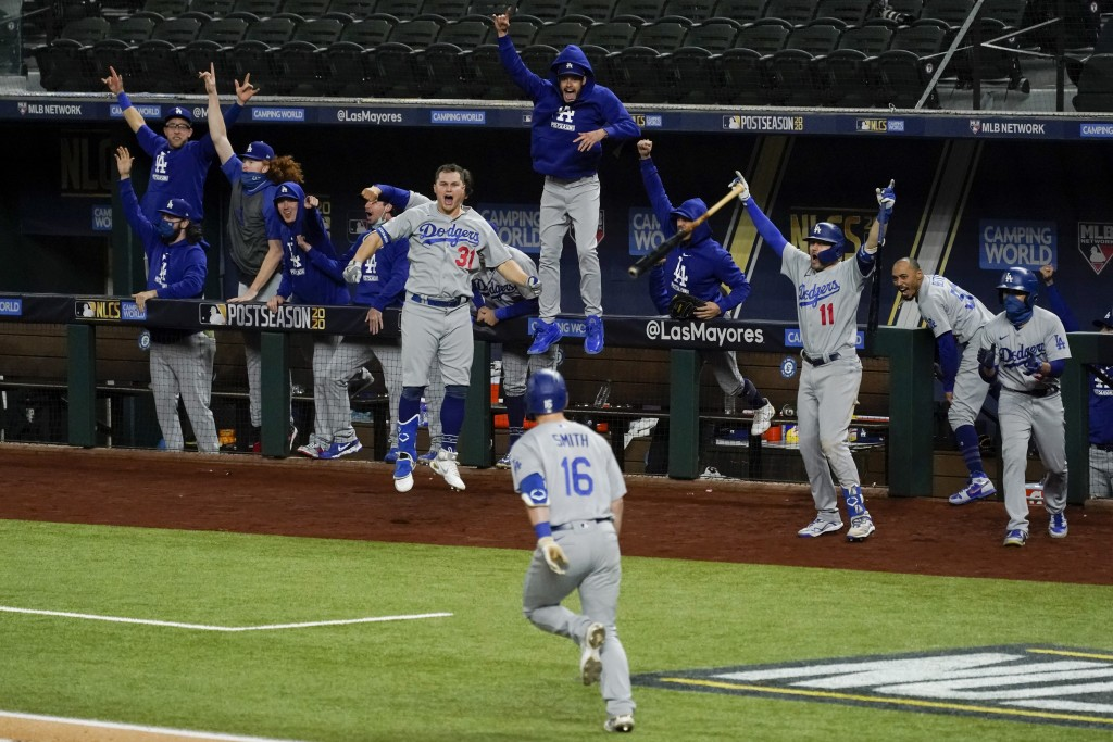 The Los Angeles Dodgers celebrate a three-run home run by Will Smith against the Atlanta Braves during the sixth inning in Game 5 of a baseball Nation...