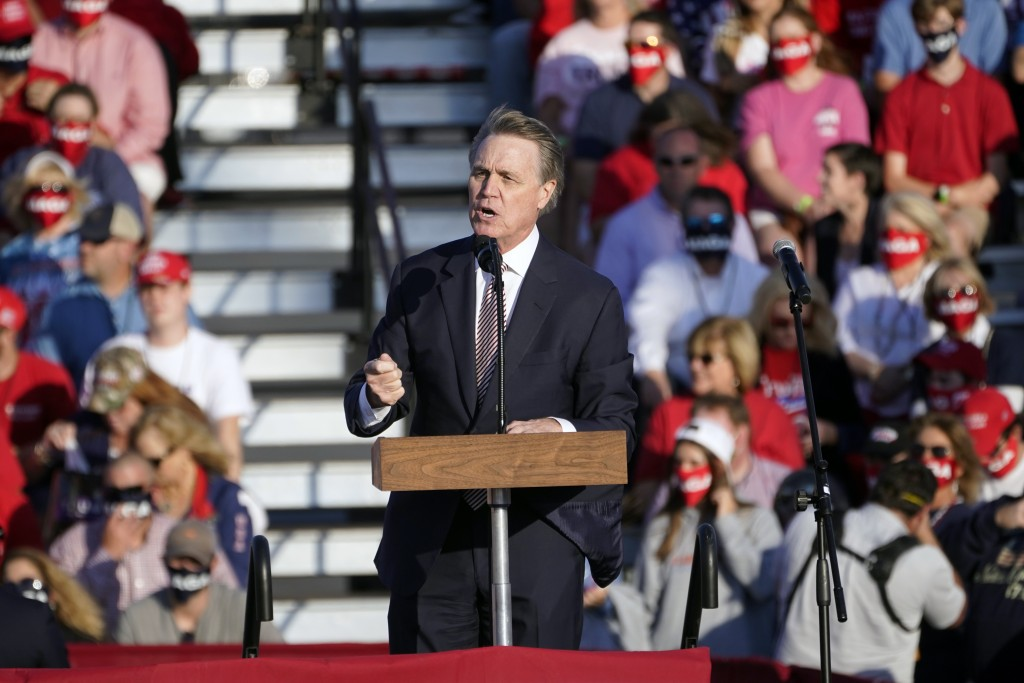 Sen. David Perdue, R-Ga., speaks during a campaign rally for President Donald Trump at Middle Georgia Regional Airport, Friday, Oct. 16, 2020, in Maco...