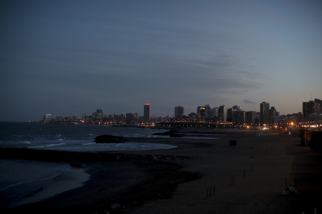 The sun sets during the COVID-19 pandemic in Mar del Plata, Argentina, Saturday, Oct. 10, 2020. The resort's new reality is starkly visible: Its beach...