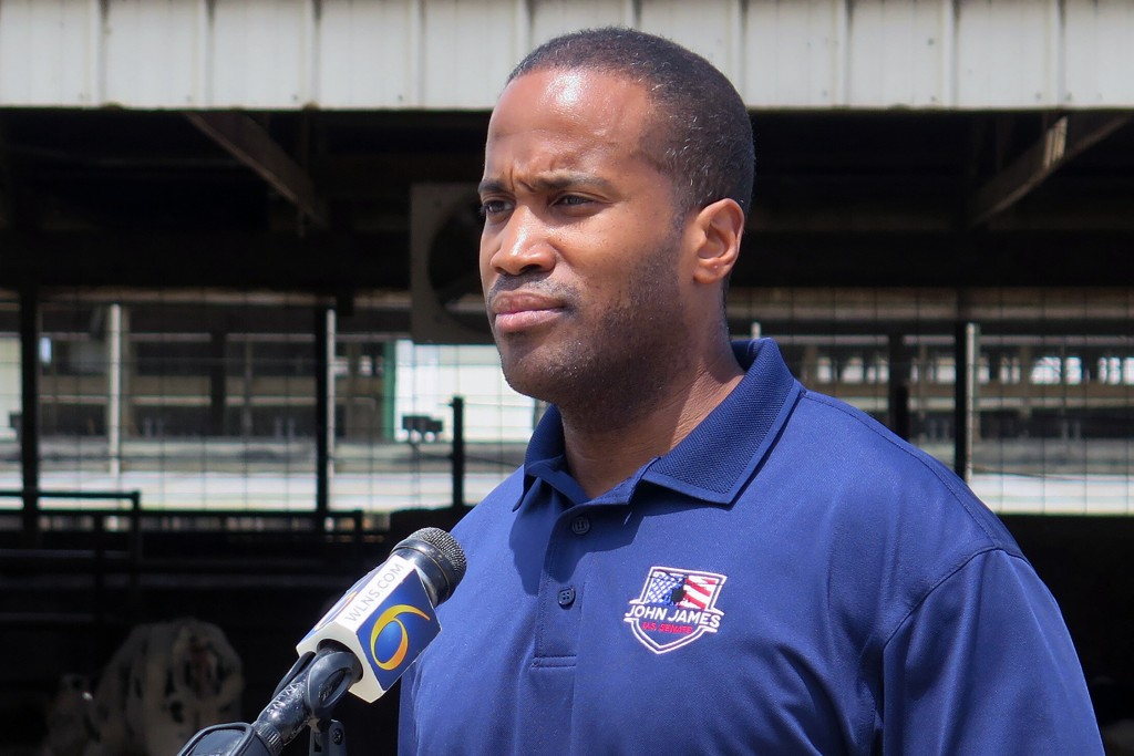 FILE - In this Monday, June 22, 2020, file photo, Republican U.S. Senate candidate John James speaks at Weir Farms in Hanover Township, Mich. First-te...