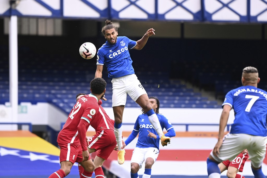 Everton's Dominic Calvert-Lewin, top, scores his side's second goal to make the score 2-2 during the English Premier League soccer match between Evert...