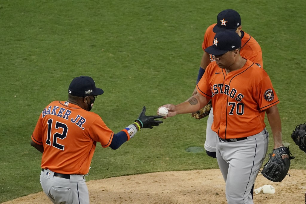 Houston Astros pitcher Andre Scrubb (70) is relieved by Houston Astros manager Dusty Baker Jr. during the seventh inning in Game 6 of a baseball Ameri...