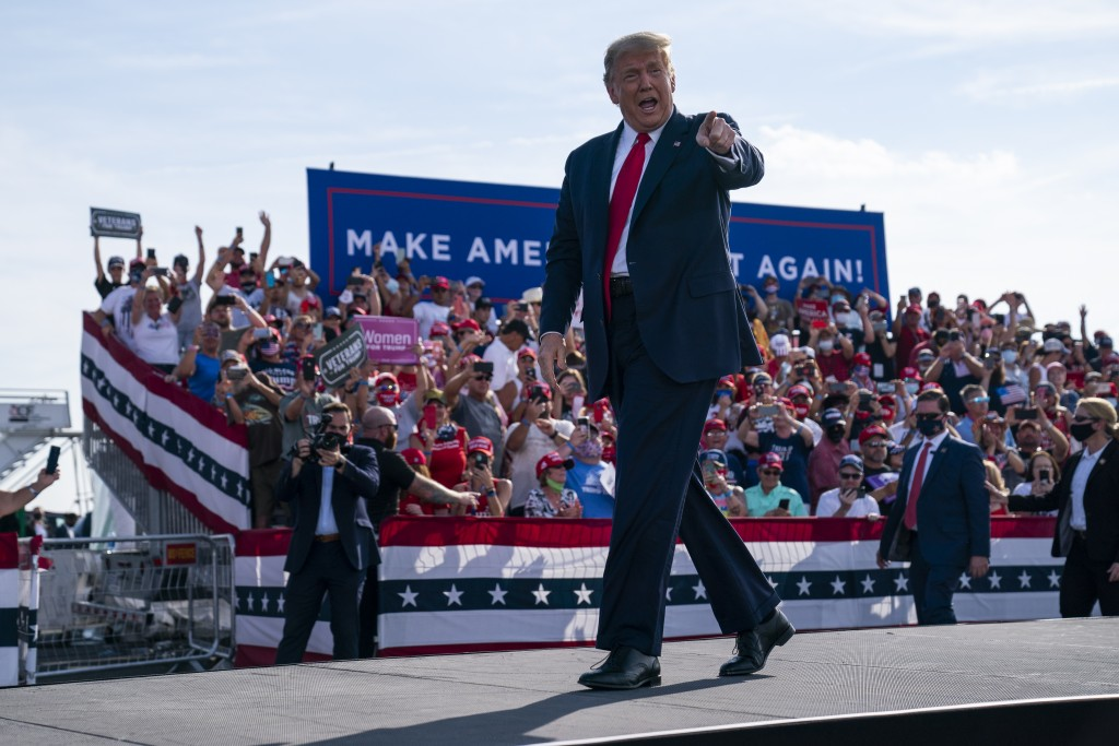 President Donald Trump arrives to speak to a campaign rally at Ocala International Airport, Friday, Oct. 16, 2020, in Ocala, Fla. (AP Photo/Evan Vucci...