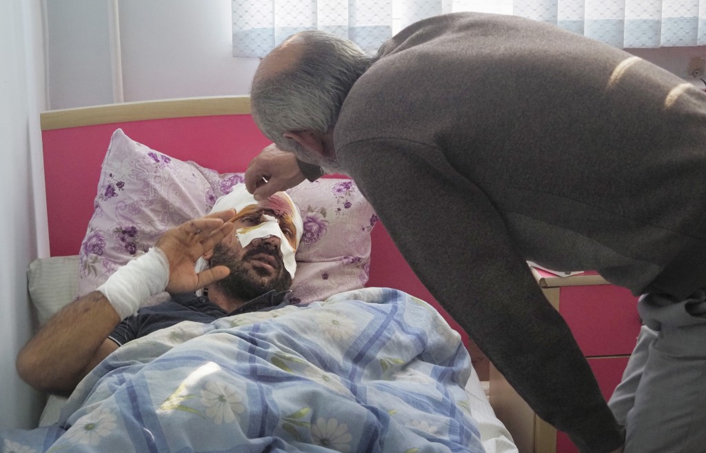 Yury Melkonyan visits his son wounded from shelling by Azerbaijan's artillery in a hospital, during a military conflict in Stepanakert, the separatist...