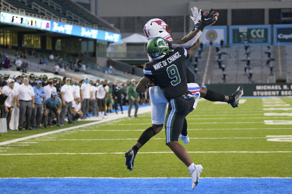 SMU wide receiver Rashee Rice (11) reaches for a touchdown pass against Tulane cornerback Jaylon Monroe (9) during an NCAA college football game in Ne...
