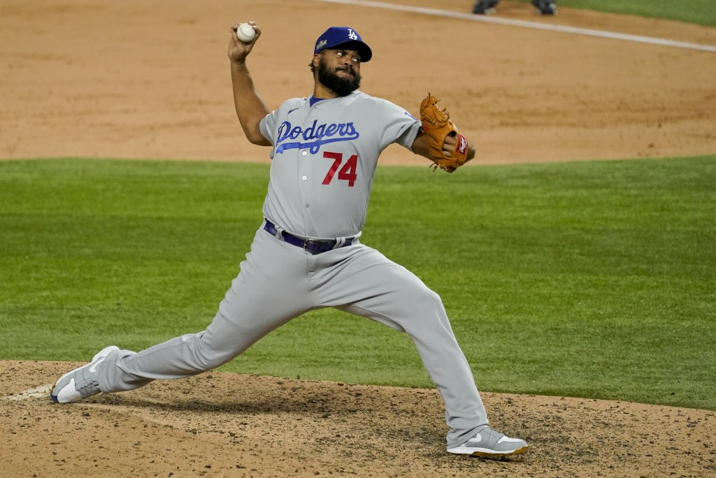 Los Angeles Dodgers relief pitcher Kenley Jansen throws against the Atlanta Braves during the ninth inning in Game 5 of a baseball National League Cha...