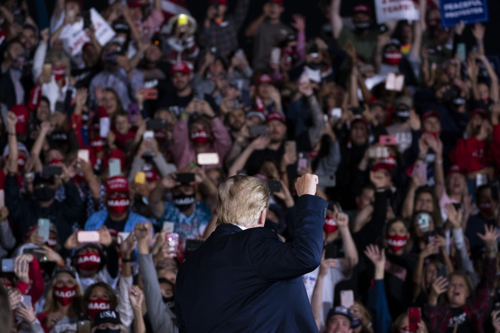President Donald Trump arrives to speak to a campaign rally at Middle Georgia Regional Airport, Friday, Oct. 16, 2020, in Macon, Ga. (AP Photo/Evan Vu...