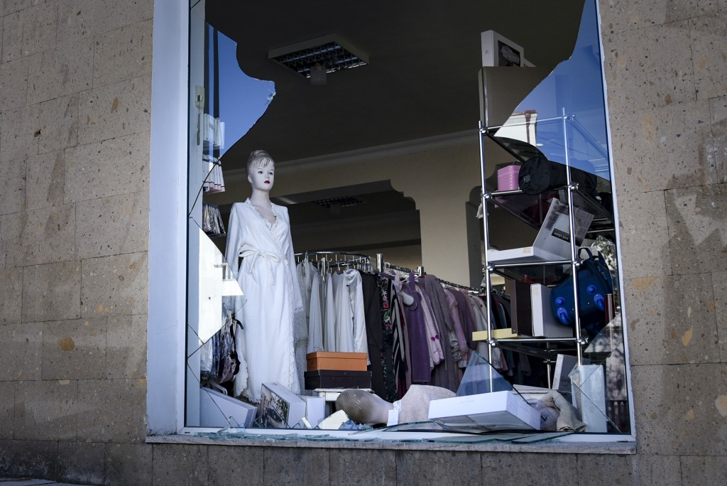 A view of a window of a clothing store, hit by shelling, during a military conflict in Stepanakert in the separatist region of Nagorno-Karabakh, Satur...