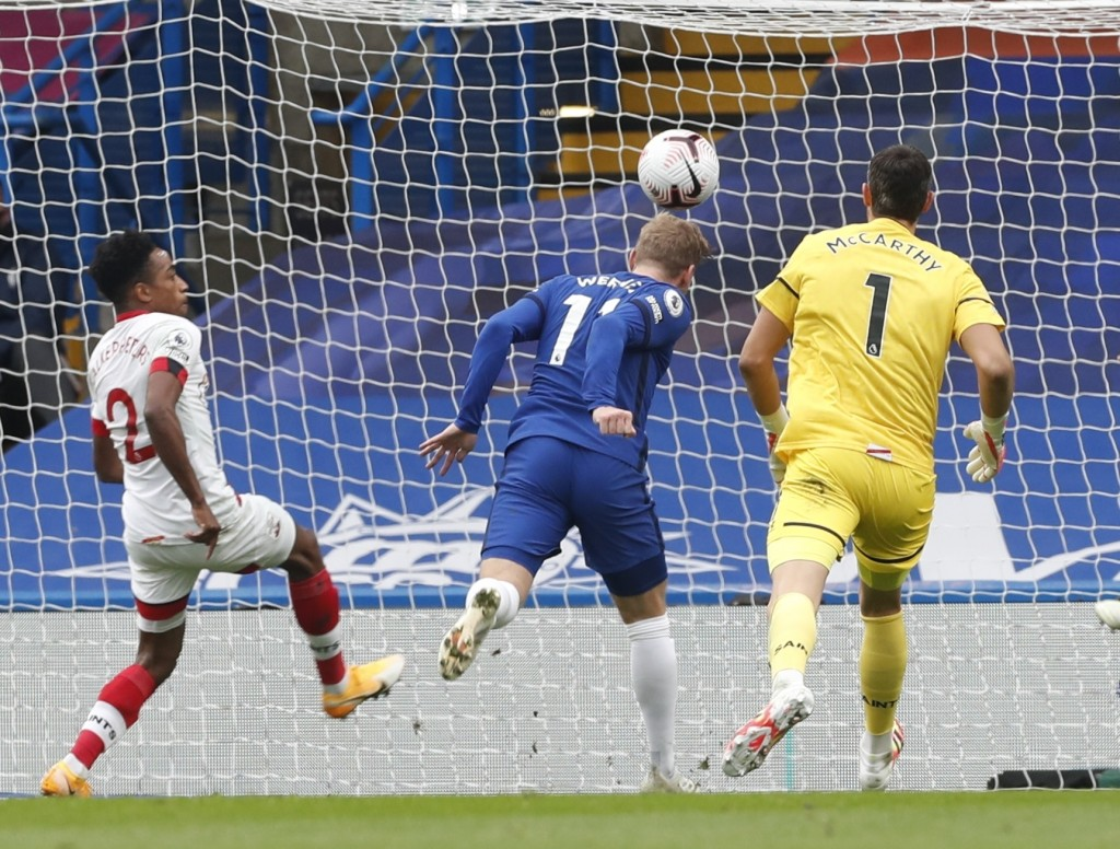 Chelsea's Timo Werner, center, scores his side's second goal during the English Premier League soccer match between Southampton and Chelsea at the Sta...