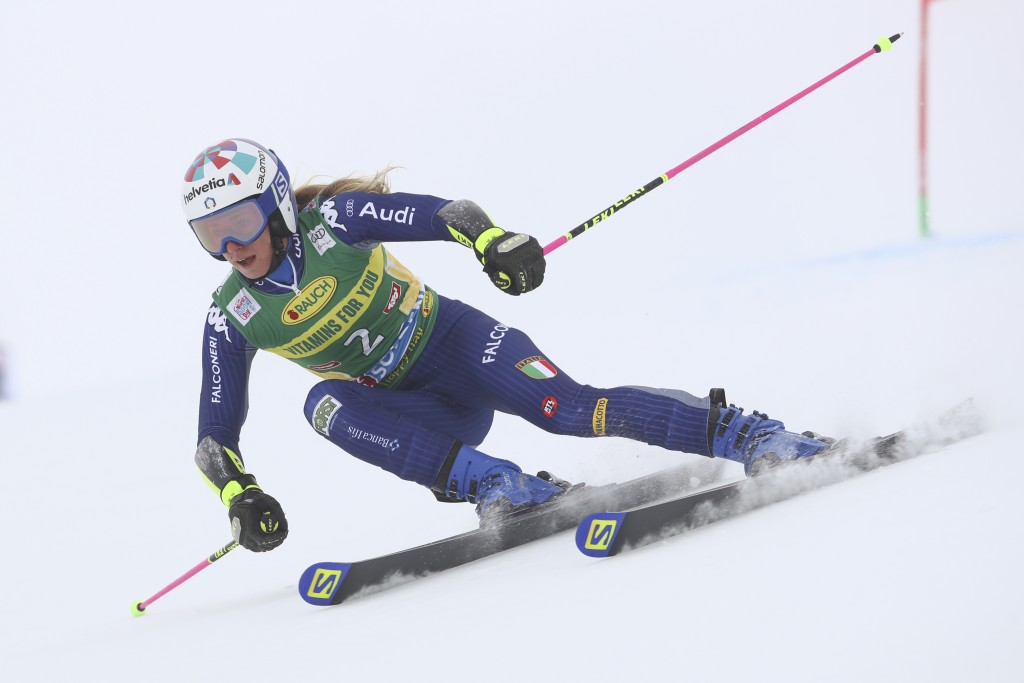 Italy's Marta Bassino speeds down the course during an alpine ski, women's World Cup giant slalom in Soelden, Austria, Saturday, Oct. 17, 2020. (AP Ph...
