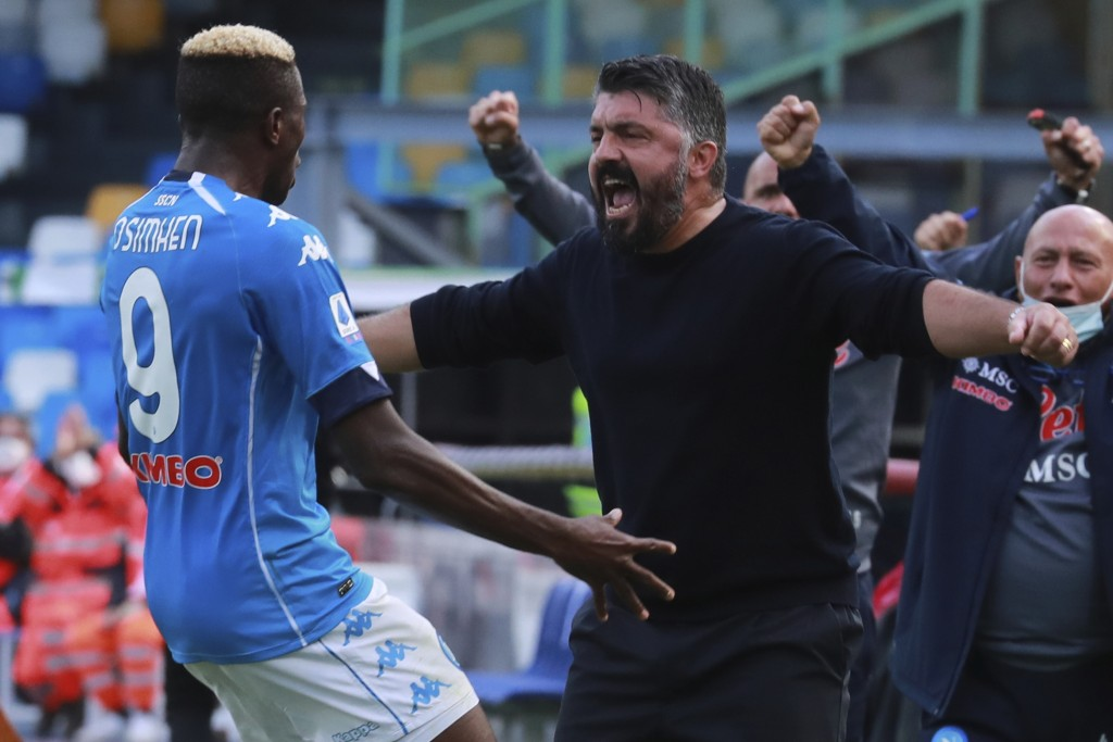 Napoli's Victor Osimhen celebrates with coach Gennaro Gattuso after scoring his side's fourth goal during the Serie A soccer match between Napoli and ...