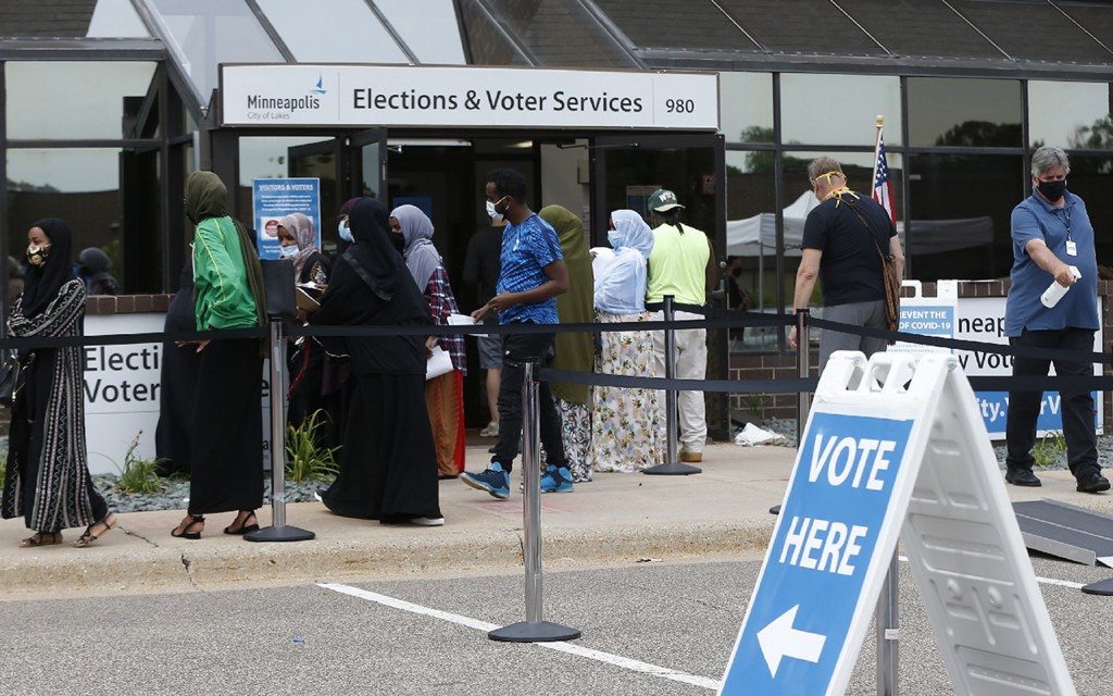 FILE - In this Aug. 10, 2020, file photo, Minneapolis voters line up to vote a day ahead of Minnesota's Tuesday primary election at the Minneapolis El...