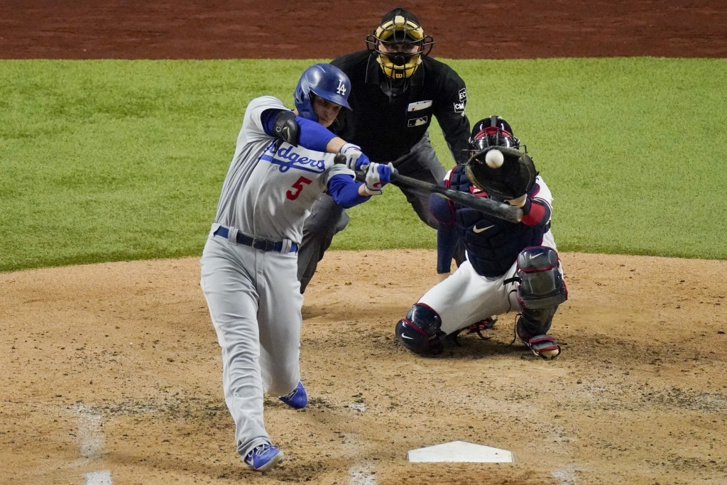 Los Angeles Dodgers' Corey Seager hits a home run against the Atlanta Braves during the fourth inning in Game 5 of a baseball National League Champion...