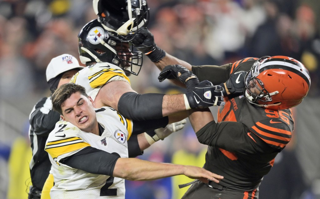 FILE - In this Nov. 14 2019, file photo, Cleveland Browns defensive end Myles Garrett (95) hits Pittsburgh Steelers quarterback Mason Rudolph (2) with...