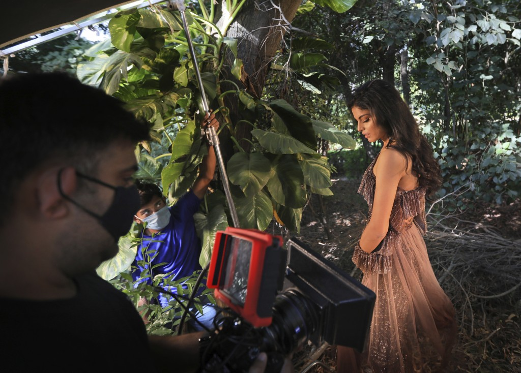 A model poses during a photo shoot for the Lotus Make-up India Fashion Week, at  the farmhouse of a designer, in New Delhi, India, Friday, Oct. 2, 202...