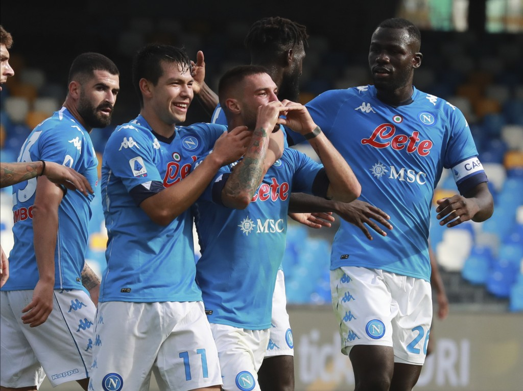 Napoli's  Matteo Politano celebrates with teammate Hirving Lozano after scoring his side's third goal during the Serie A soccer match between Napoli a...