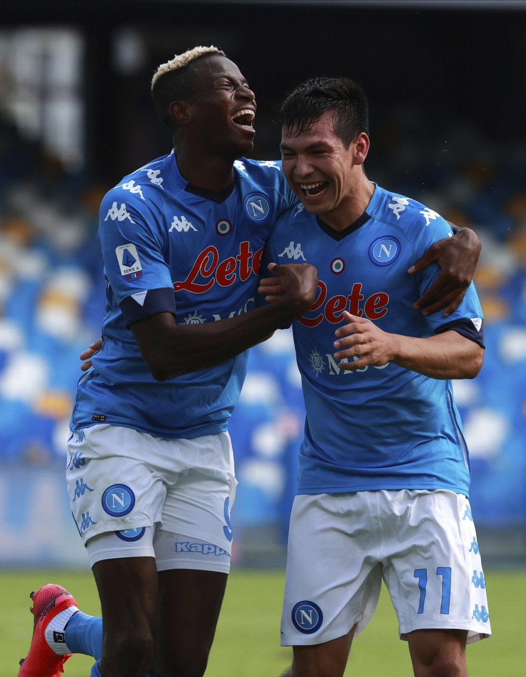 Napoli's Hirving Lozano, right, celebrates with teammate Victor Osimhen after scoring his side's second goal during the Serie A soccer match between N...