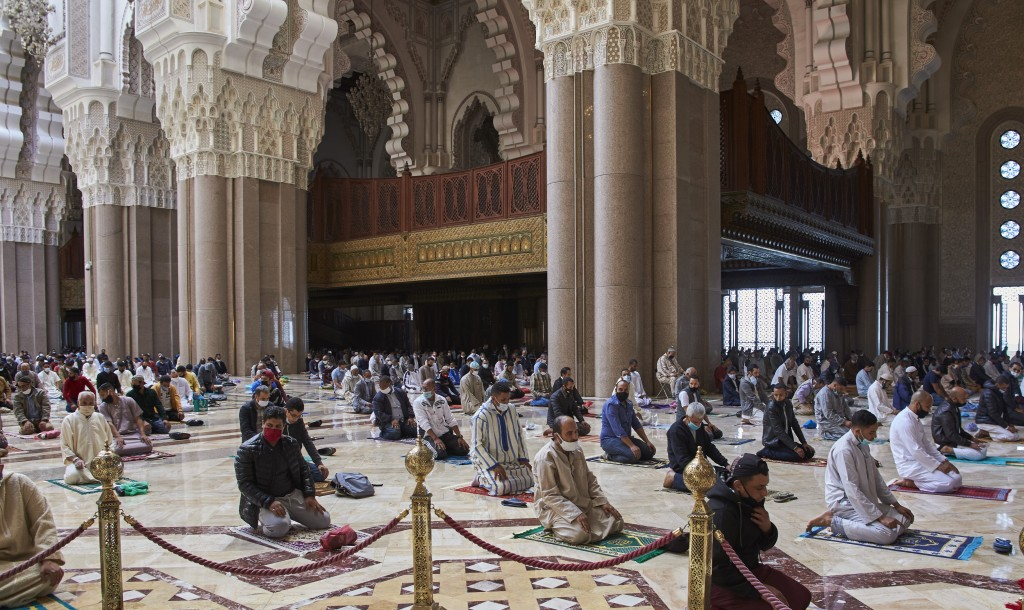 Moroccans wear face masks and pray respecting social distancing at the great Hassan II Mosque in Casablanca, Morocco, Friday, Oct. 16, 2020. In Morocc...