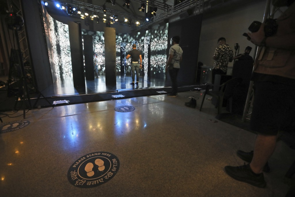 Signs of social distancing are pasted on the sets for the Lotus make-up India Fashion week digital show in New Delhi, India, Friday, Oct. 2, 2020. Ind...