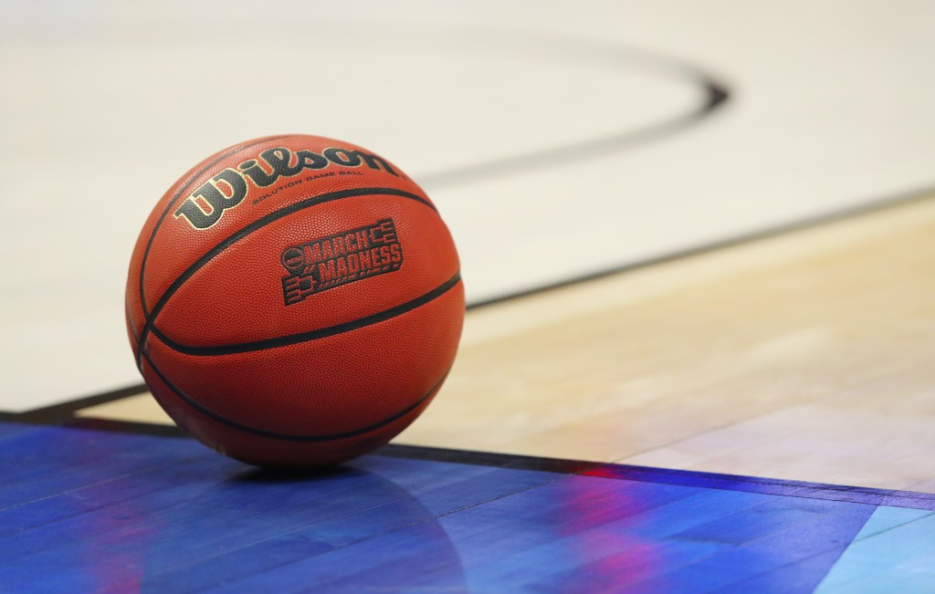 FILE -- In this March 18, 2017, file photo, an official game ball with the March Madness logo sits in the court during a second-round men's college ba...