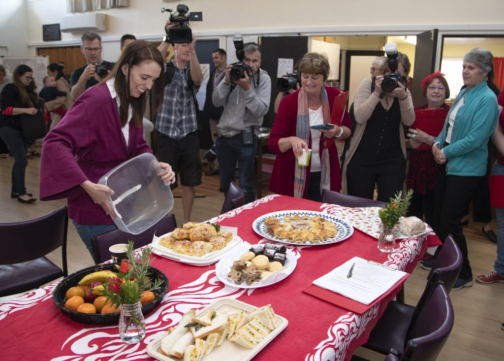 New Zealand Prime Minister Jacinda Ardern unveils her homemade cheese scones as she arrives at an event to thank her electorate workers in Auckland, N...