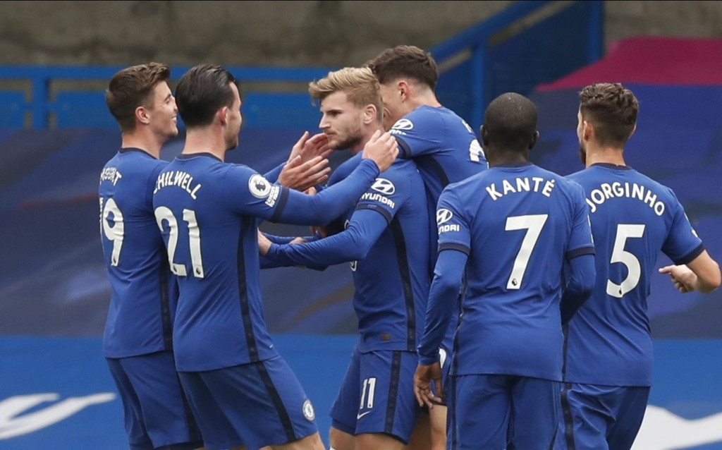 Chelsea's Timo Werner, center, celebrates after scoring the opening goal during the English Premier League soccer match between Southampton and Chelse...
