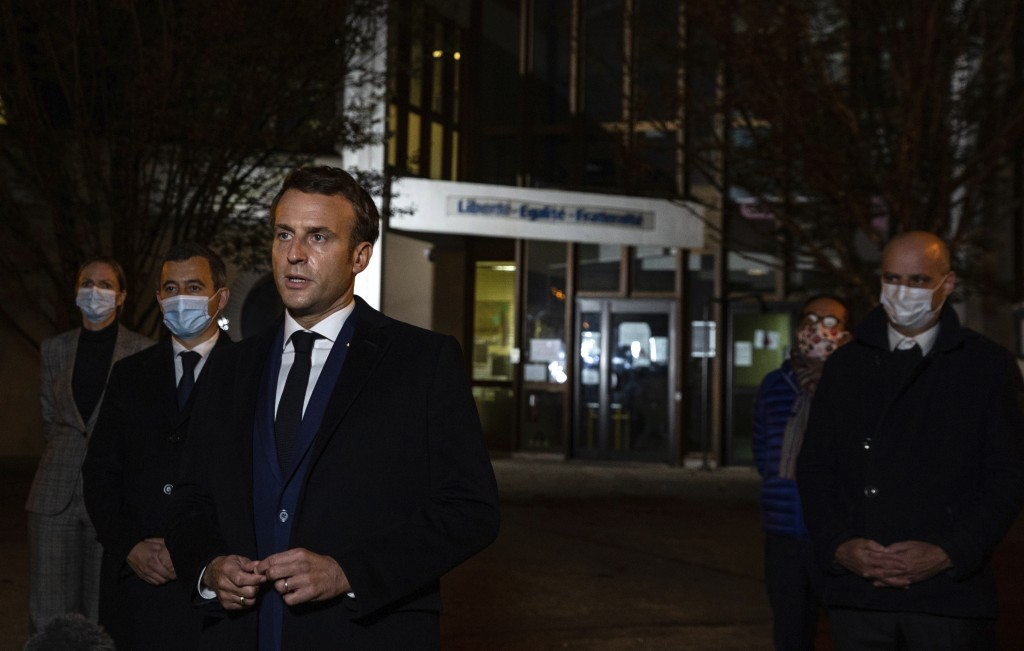 French President Emmanuel Macron, flanked by French Interior Minister Gerald Darmanin, second left, and French Education Minister Jean-Michel Blanquer...