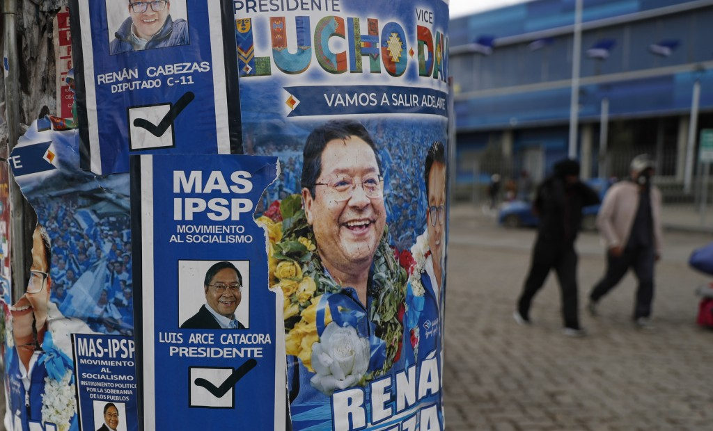 Election posters promoting presidential candidate and one of two leading contenders Luis Arce, representing the Movement Towards Socialism political p...