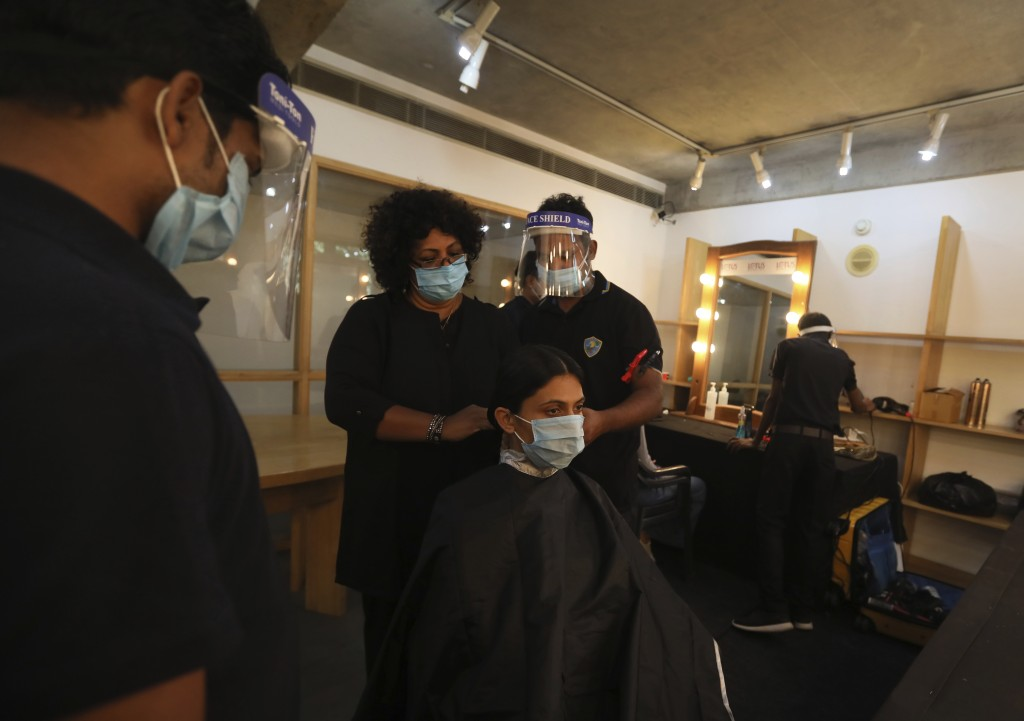 A model gets her hair done for a shoot for the Lotus make-up India Fashion week digital show at the Fashion Design Council of India (FDCI) office in N...