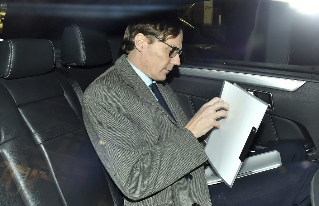 FILE - In this Tuesday March 20, 2018 file photo, Alexander Nix, chief executive of Cambridge Analytica, leaves his offices in central London. Documen...