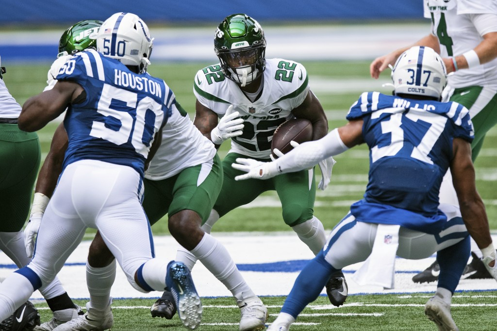 FILE - In this Sept. 27, 2020, file photo, New York Jets running back La'Mical Perine (22) looks for an opening in the line during an NFL football gam...