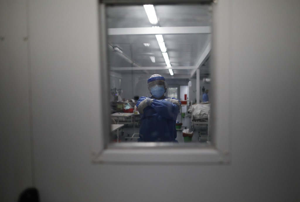 A doctor poses for a photo inside the intensive care unit designated for people infected with COVID-19 at a hospital in Mar del Plata, Argentina, Satu...