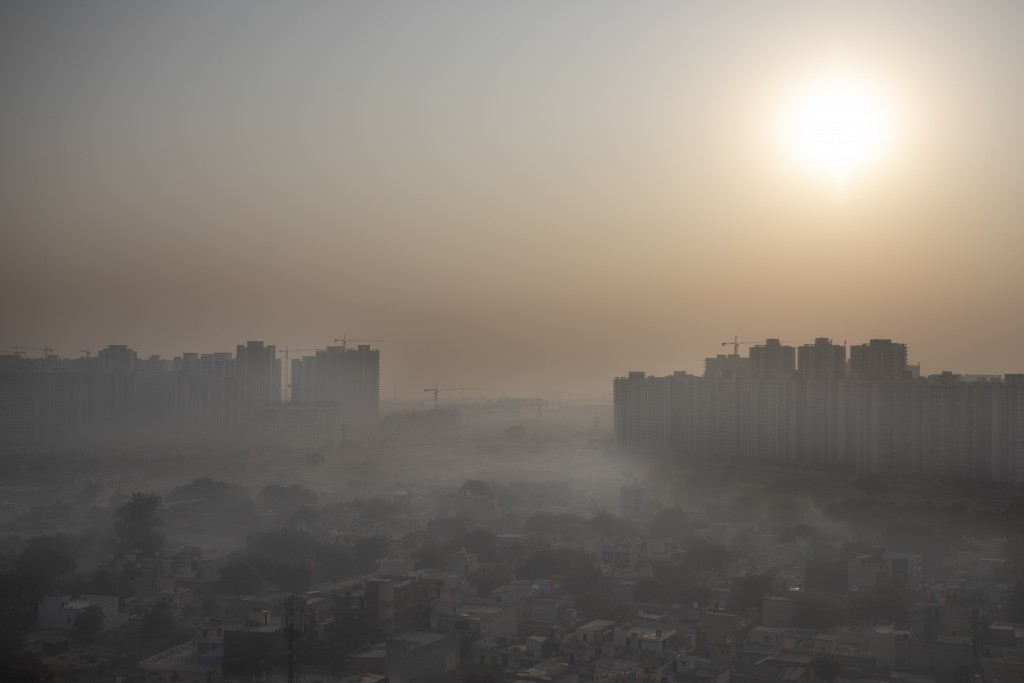 Morning haze envelops the skyline on the outskirts of New Delhi, India, Friday, Oct. 16, 2020. The national capital, one of the world's most polluted ...