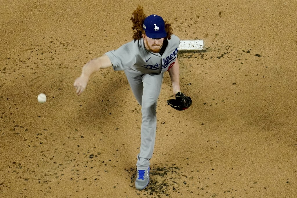 Los Angeles Dodgers starting pitcher Dustin May throws against the Atlanta Braves during the first inning in Game 5 of a baseball National League Cham...
