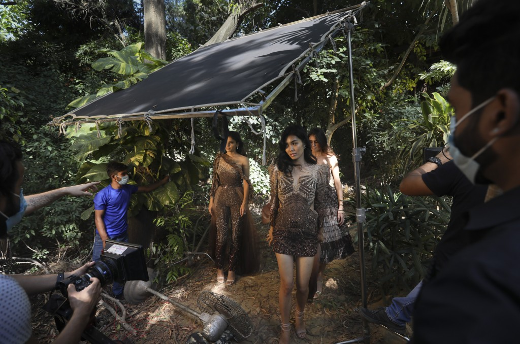 Models pose during a photo shoot for the Lotus Make-up India Fashion Week, at  the farmhouse of a designer in New Delhi, India, Friday, Oct. 2, 2020. ...