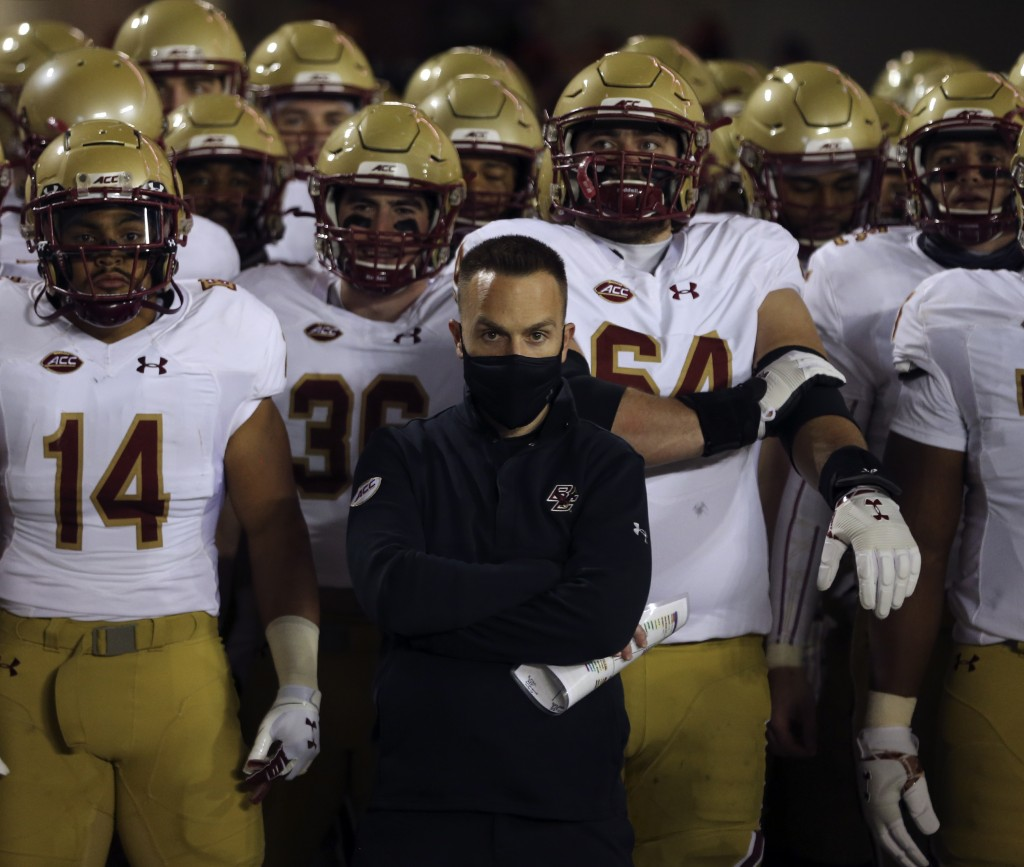 Boston College head coach Jeff Hafley and his team wait to take the field at the start of the first half of an NCAA college football game against Virg...