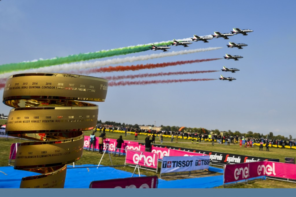 The Giro d'Italia trophy is backdropped by the Frecce Tricolori Italian Air Force aerobatic squad flying past, prior to the 15th stage of the Giro d'I...