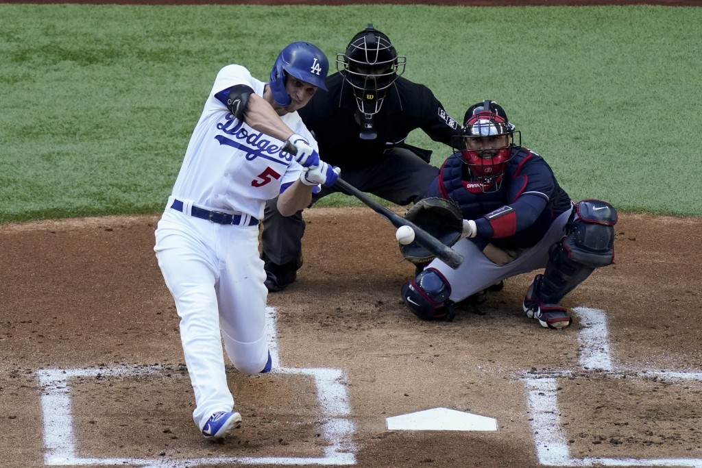 Los Angeles Dodgers' Corey Seager watches his home run against the Atlanta Braves during the first inning in Game 6 of a baseball National League Cham...