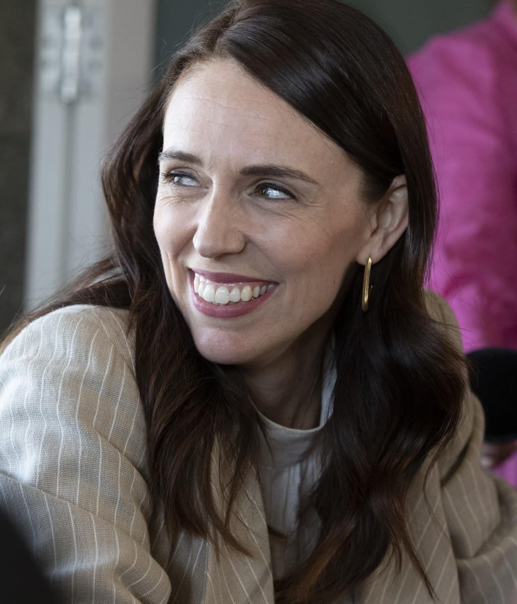 New Zealand Prime Minister Jacinda Ardern reacts as she talks with colleagues at a cafe in Auckland, New Zealand, Sunday, Oct. 18, 2020. Ardern has wo...