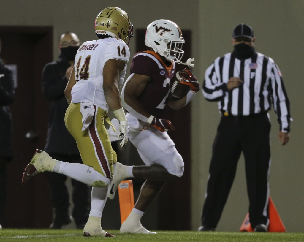 Khalil Herbert, right, of Virginia Tech scores past Sam Johnson III of Boston College in the first half of an NCAA college football game in Blacksburg...