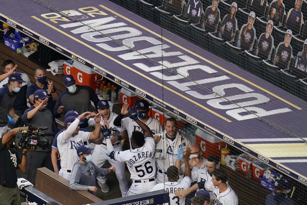 Tampa Bay Rays Randy Arozarena celebrates with his teammates after hitting a two run home run against Houston Astros pitcher Lance McCullers Jr. (43) ...